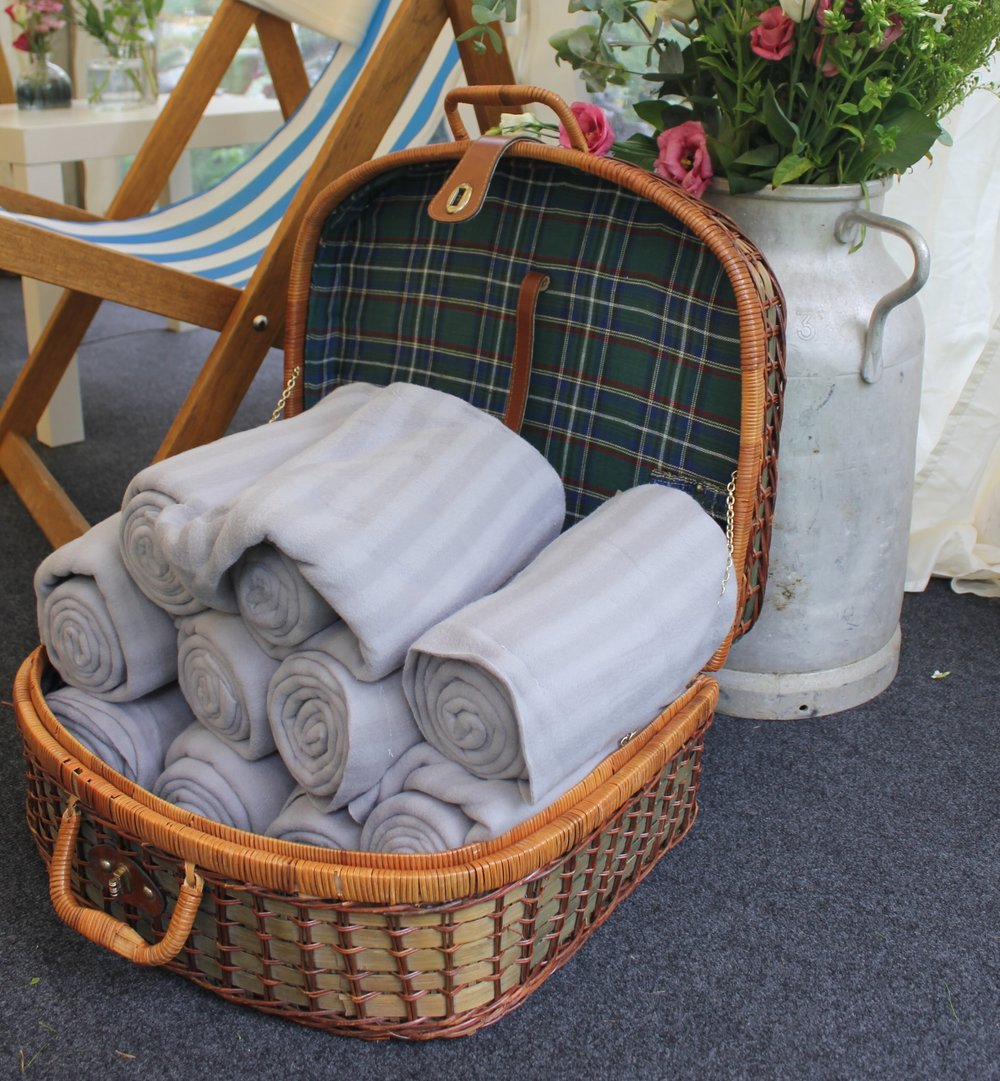 Vintage picnic basket perfect for displaying throws or other items. One available £15 to hire. Grey throws available @ £5 each per hire.