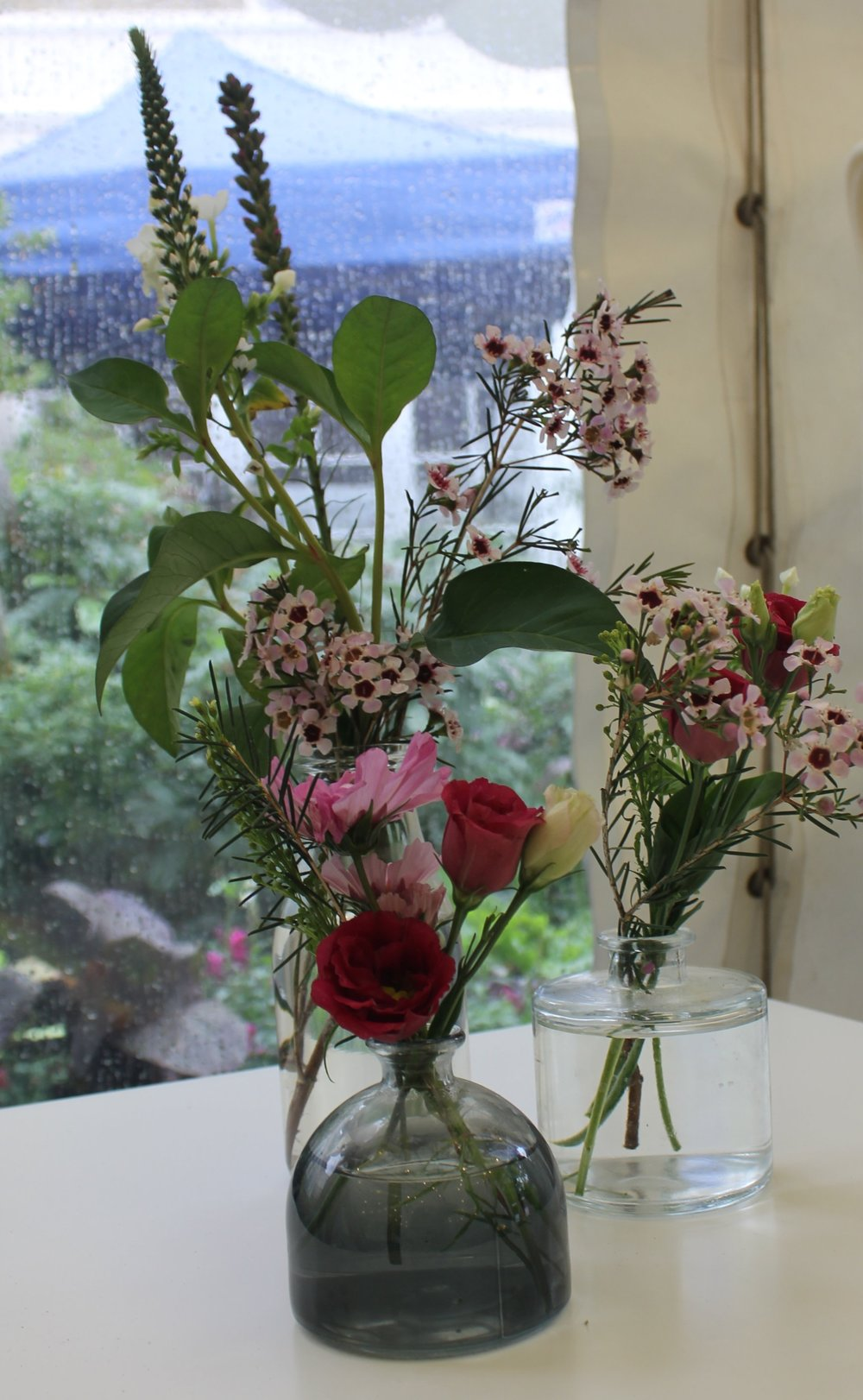 A variety of glass table vases in different heights and style. Please enquire for further information