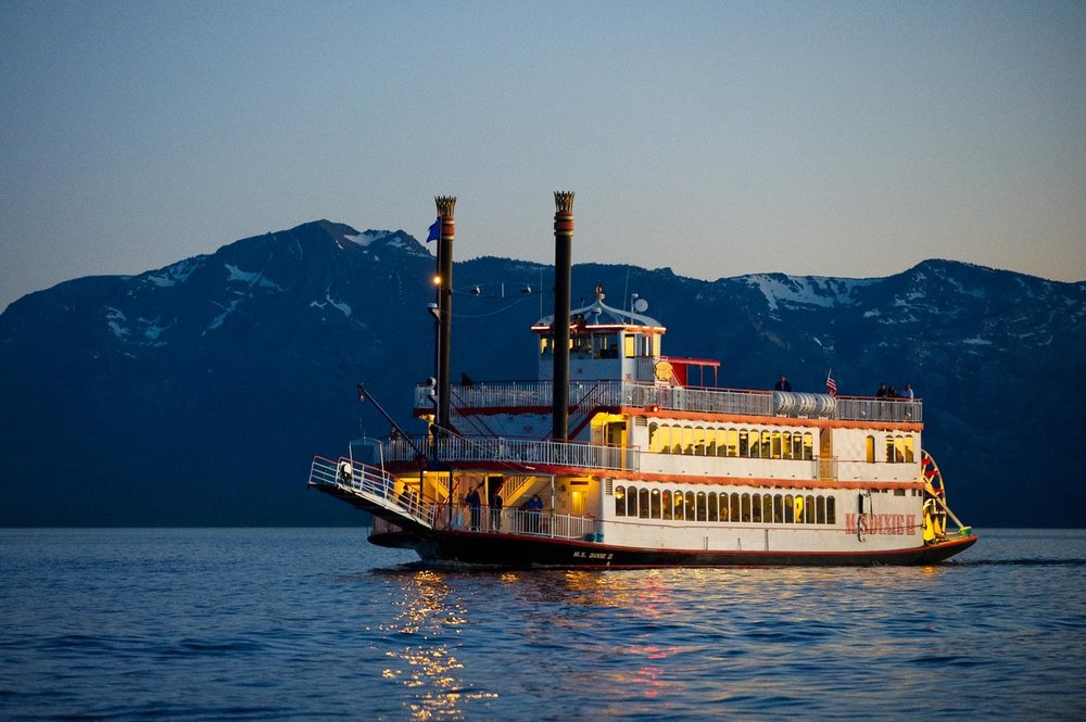 Old timey looking paddle wheel boat + a little TBL special sauce = The most radical booze cruise the high sierra mountains have ever seen.     The Plan - Take an afternoon cruise for 2 hours of feet shuffling dancing and zany sightseeing along the picturesque coast of Lake Tahoe.