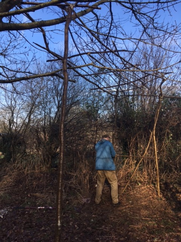 My friend Dragan putting the finishing touches to the hazel bridge - winter 2017
