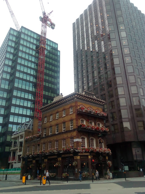 Old and new: buildings in Victoria street, London.