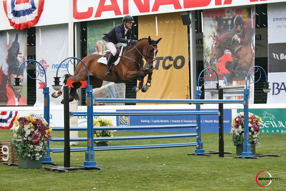 Peter Lutz and Retiro at Spruce Meadows by SportFot (1).jpg