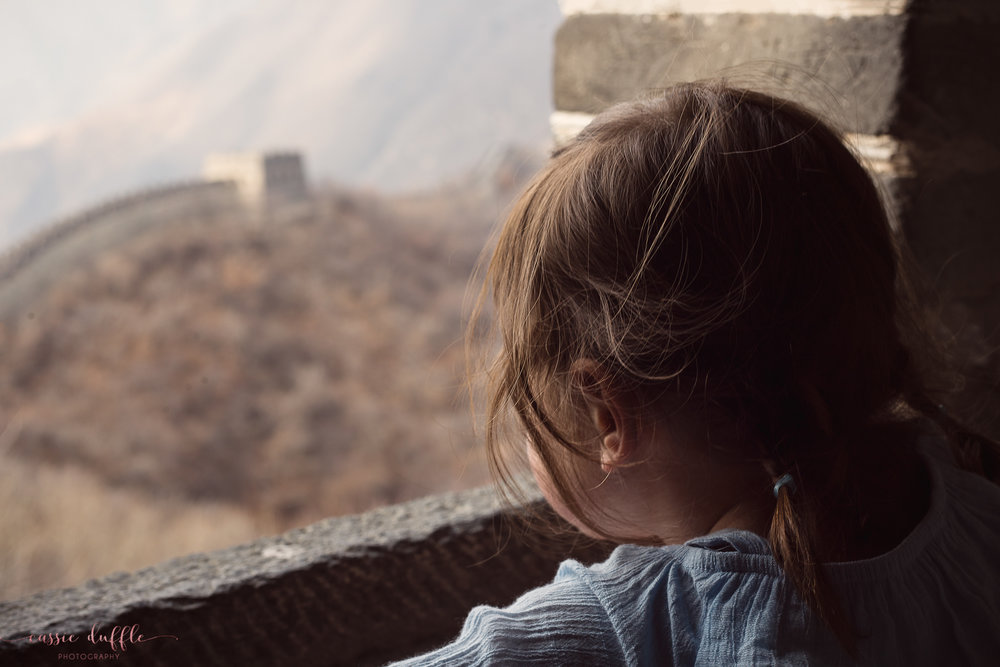 Zoe overlooking the Great Wall of China