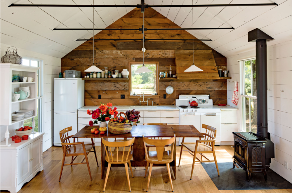 Ever since I saw this kitchen, I've been dreaming of a tiny house. It's not a true tiny house, but it's still pretty small and I love the pared down, simple wall, no frills kitchen. Click the photo for more images from this home.