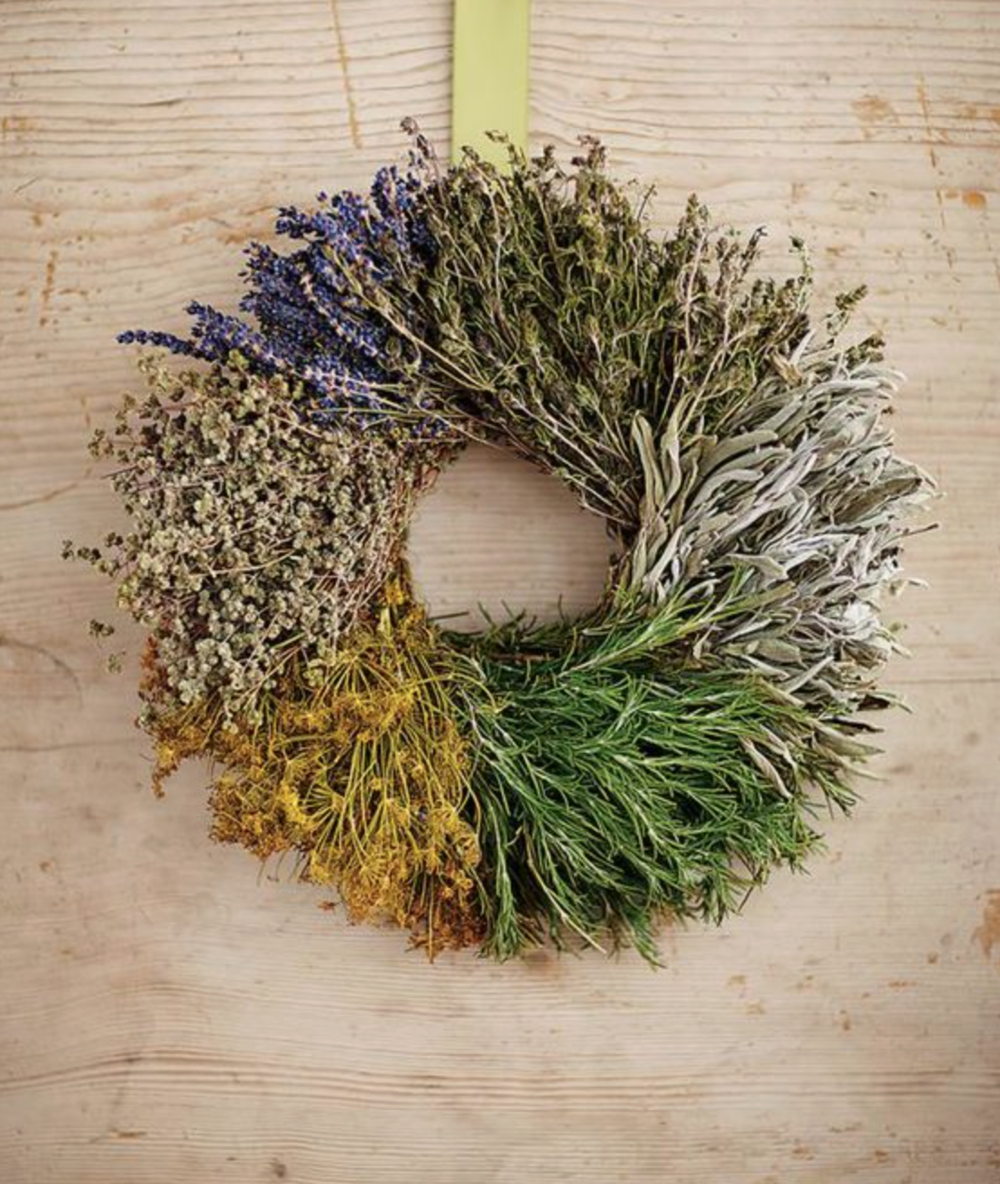 I'm determined to make, buy, borrow, or steal the makings of this wreath this fall. I love it. I don't know where this one in particular is from, I just have it saved on my  Pinterest board, D I R T .