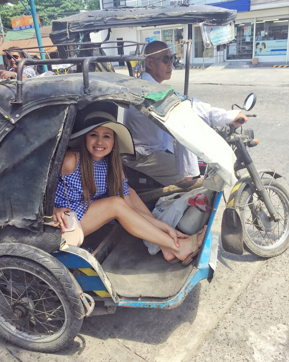 Riding a trike! Along with Jeepneys, these are the primary form of transportation!