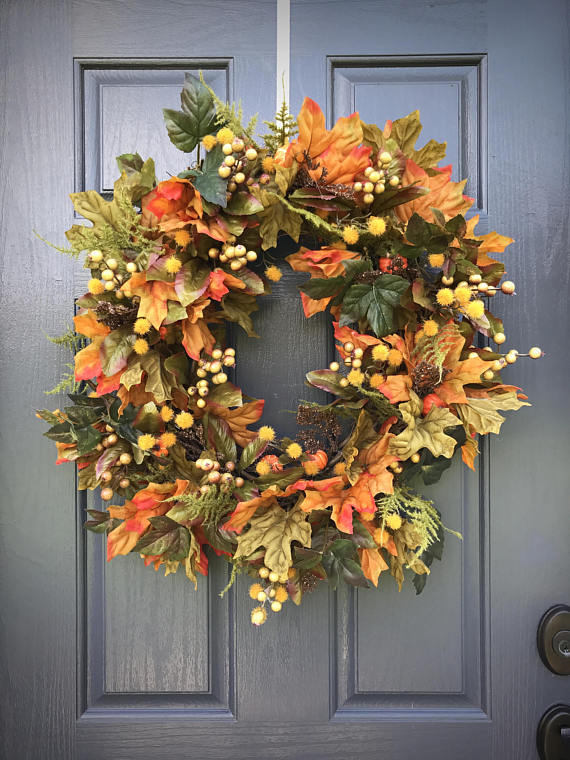 Fall Wreath - In the spirit of the season, greet visitors with this handmade, festive fall wreath outside your door.Esty
