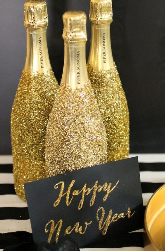 DIY Sparkle Bottles - Left over champagne from Christmas celebrations? Add some glitter to your home in time for the new year.Evite