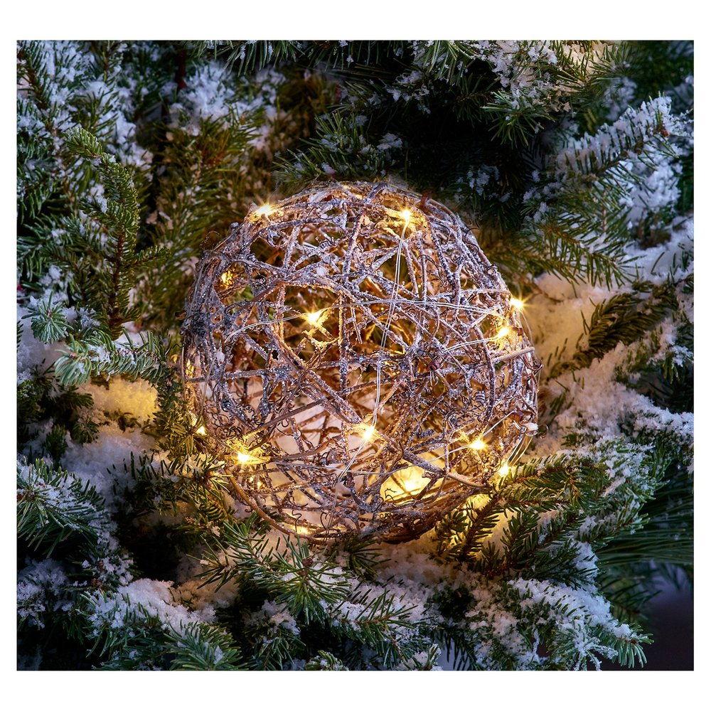 Brown Rattan Sphere - Here is a fun way to decorate your home without burying it under mountains of lights and ornaments. Place these spheres in your bushes or hang them from your awnings to give your home an eclectic forest feel.Target