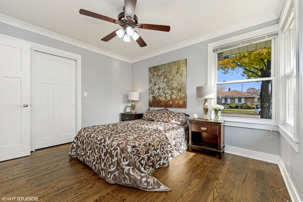 08_8156KennethAve_14_MasterBedroom_HiRes.jpg
