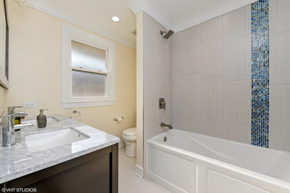 09_8156KennethAve_13_MasterBathroom_HiRes.jpg