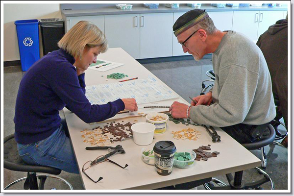 Gail Harris and Tim Gabriel concentrating on their work.