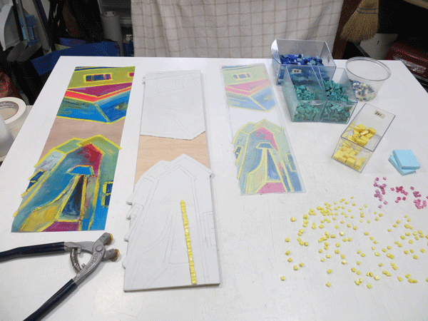 At the beginning. Copy of Rebecca's painting to left, my andamento pattern on tracing paper to the right.