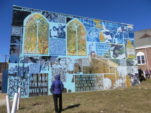 "Mosaic and painted mural titled ""Family Interrupted."" Moving commentary on living with family members in prison."