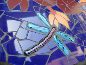 Fused glass dragonfly by JoAnn Wellner.