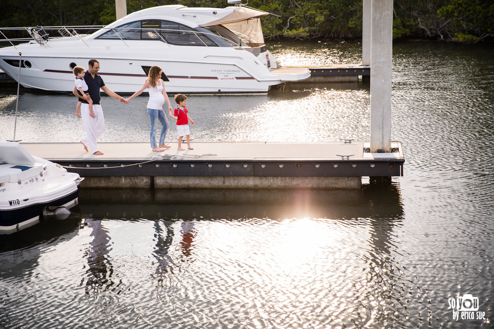 candid family photography boat dock