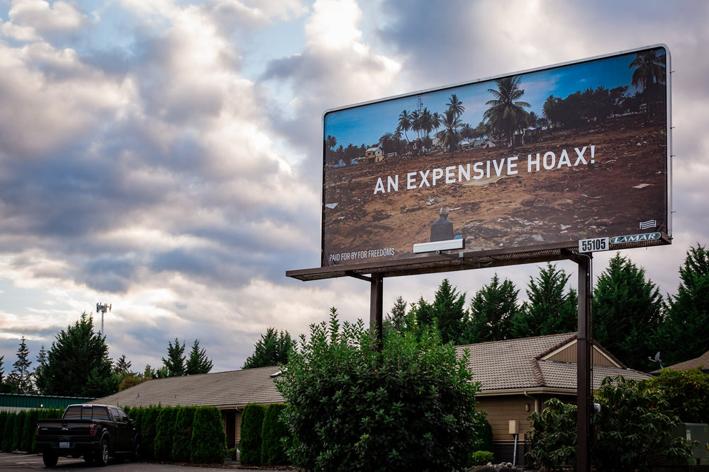 Wyatt Gallery,  An Expensive Hoax  (billboard), Olympia. WA, 2018. Image courtesy Loewyn Young and For Freedoms.