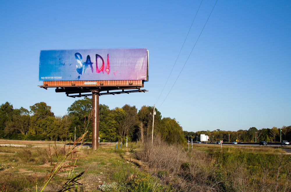 Marilyn Minter,  SAD!  (billboard), Little Rock, AR, 2018. Image courtesy Cindy Momchilov and For Freedoms.
