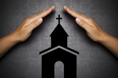 two hands over the church