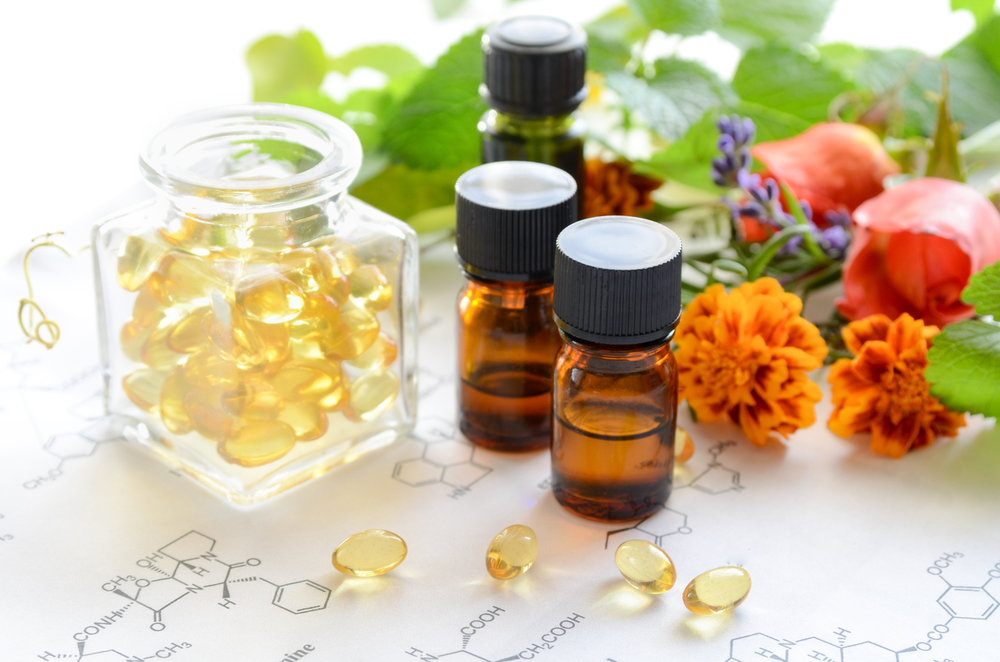 Personalized essential oil blends dispensed into capsules for health and fitness.