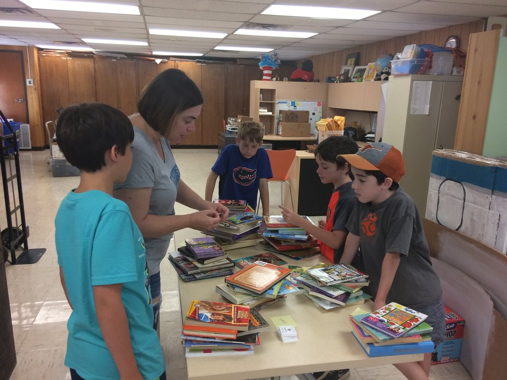 BookSpring (cont.) - A few weeks after our collection drive, we gathered at the BookSpring campus to sort and box up hundreds of books to be delivered to various school campuses and libraries.