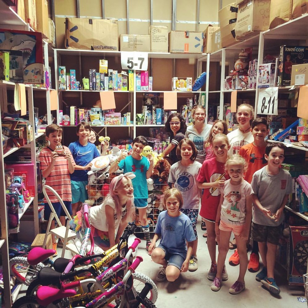 Rainbow Room / Partnerships for Children   - These amazing young Allies worked hard unpacking, sorting, itemizing, and shelving donations to be used by social workers in Austin for their young charges who are entering the foster care system.  They also wrapped and decorated gifts for Rainbow Room's Birthday Boxes.  What an fantastic crew!!