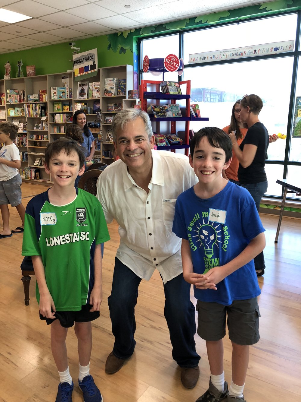 Jack and Nate visiting with Mayor Adler at an Austin Allies Book Club meeting!