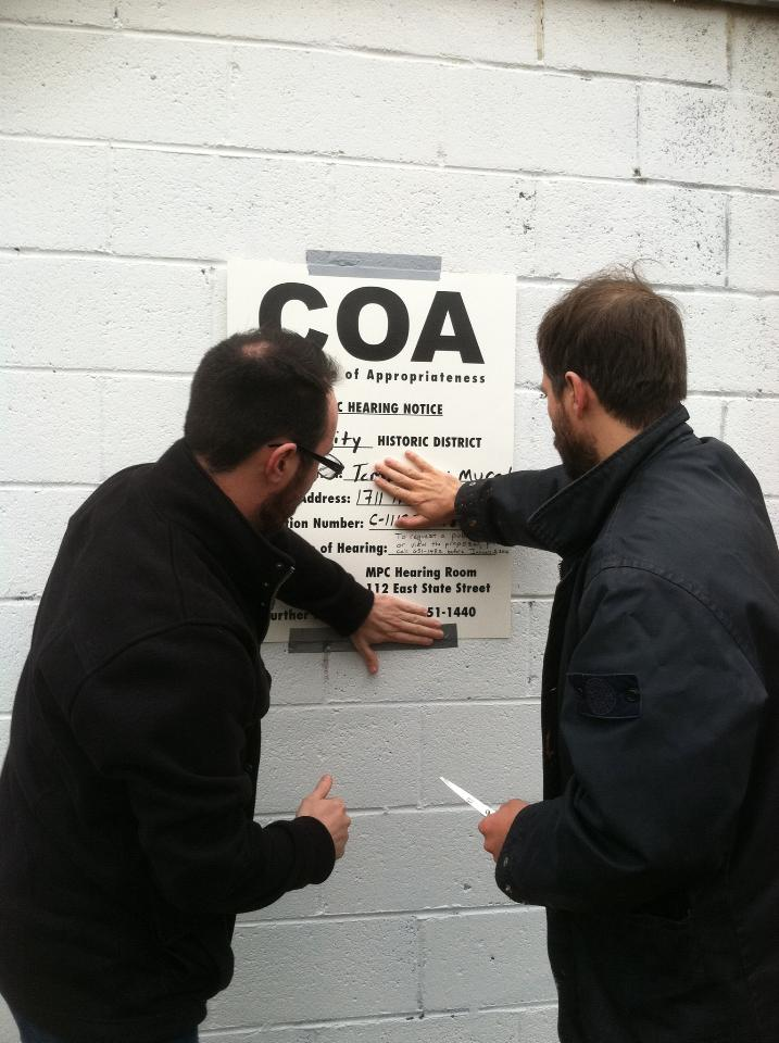James and Matt posting the first public notice for a mural petition at 34th and Habersham Street, Christmas Day, 2011.  Photo credit: Kellie Walker