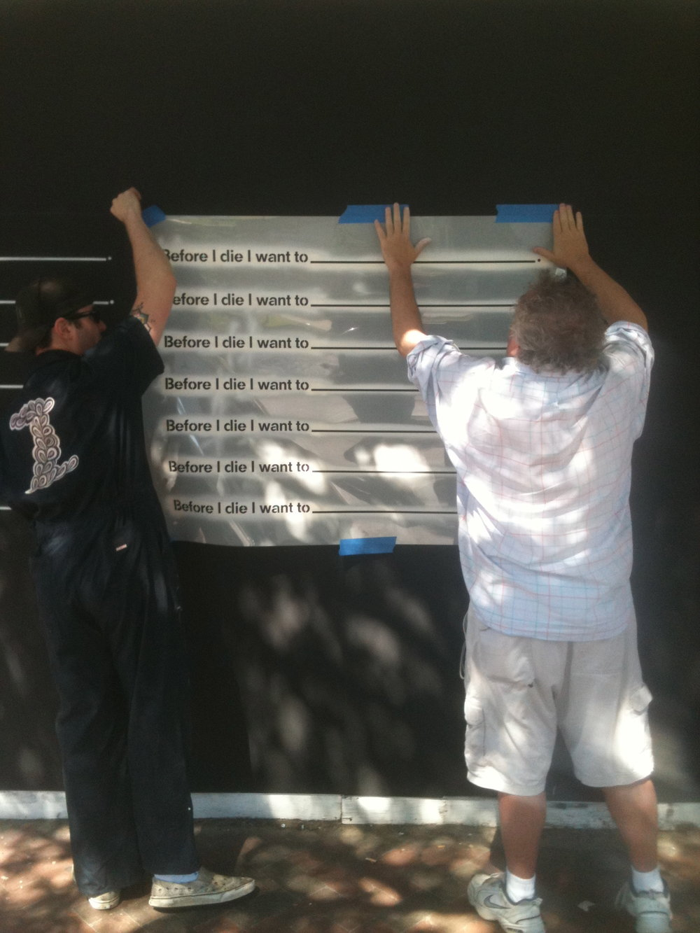James Zdaniewski and the late Francis Allen installing the template at 109 MLK.
