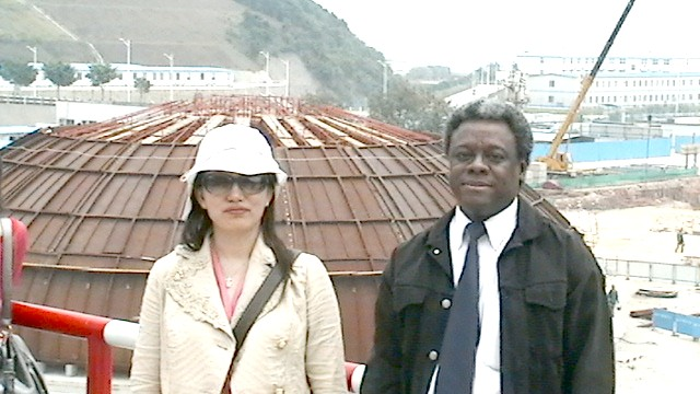 Zhang Xiaoping and Norris McDonald in front of the containment dome head for the containment dome above