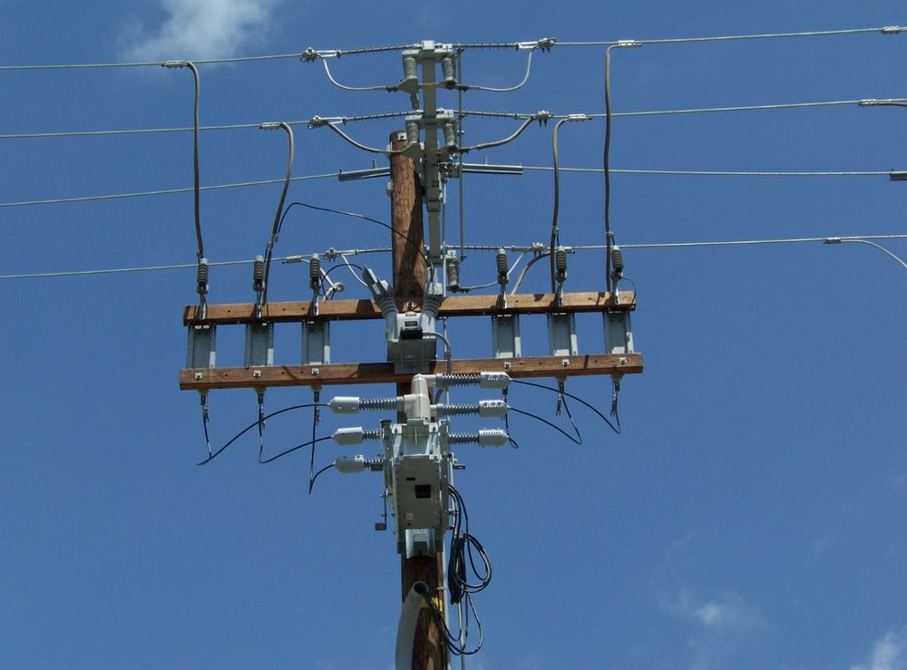 Remote Integrated Switches On A Power Pole at the Crossarm