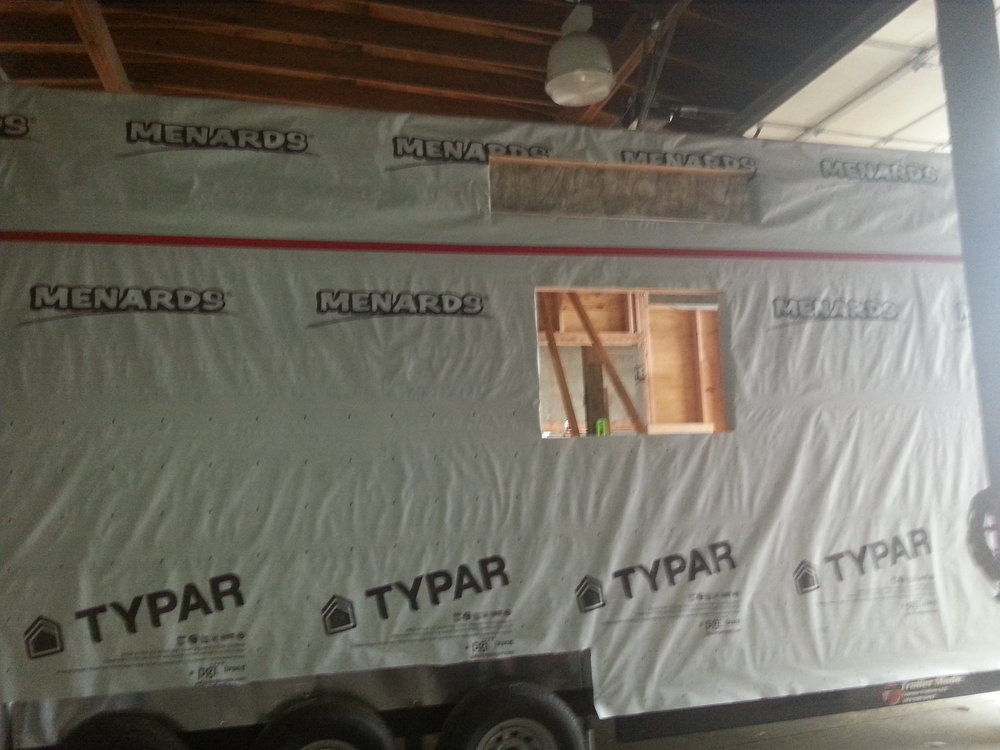 When wrapping the house make sure you start from the bottom, that way your top layer will shed water over the top of the layer beneath it. Again, dont bother cutting your window holes until you have the house wrap stapled into place.