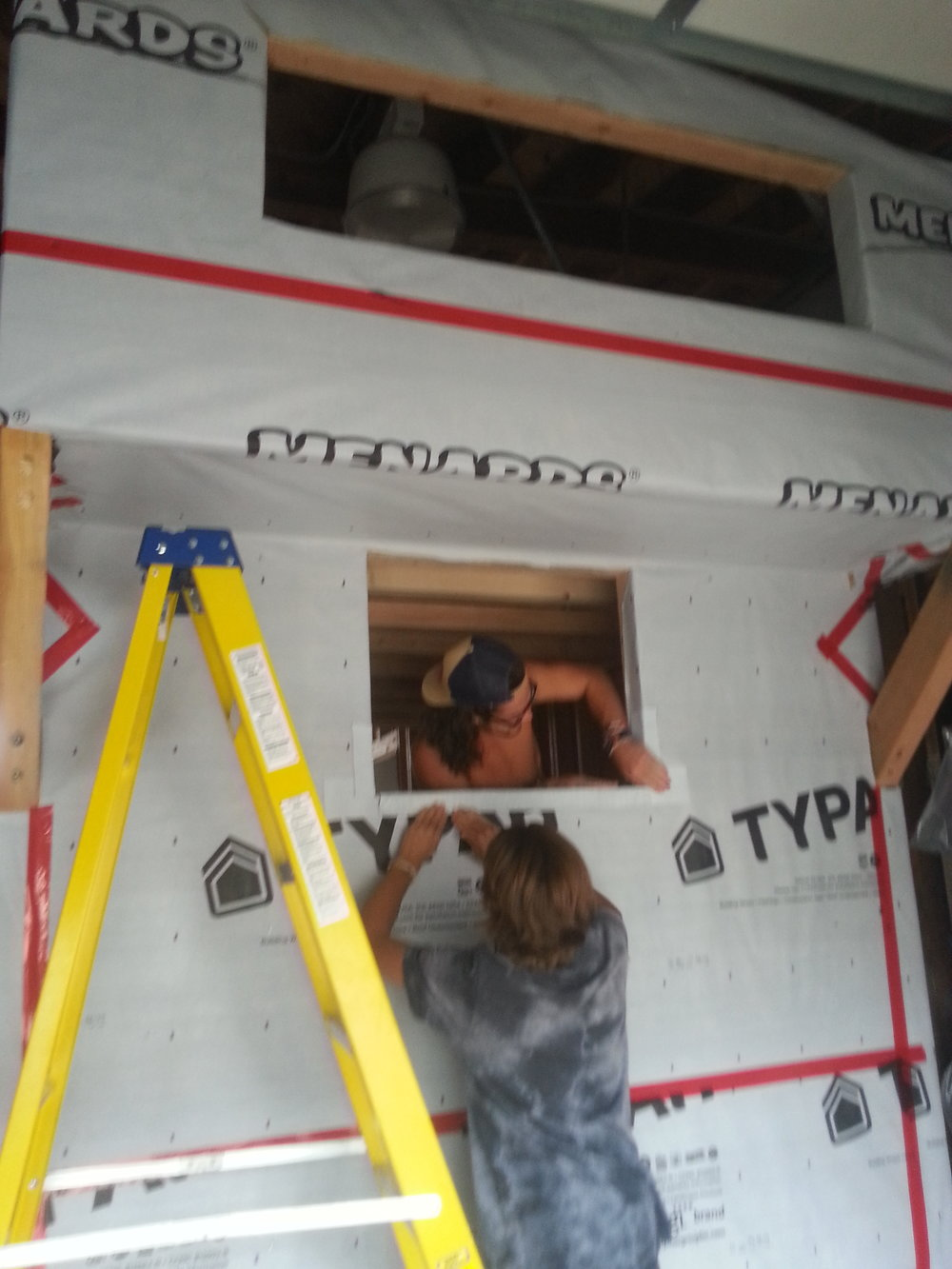 Dont be shy with the window flashing, thats the heavy sealer for your windows. start with the bottom allowing the excess to go up the framing a few inches, next the sides, then finish up with the top.