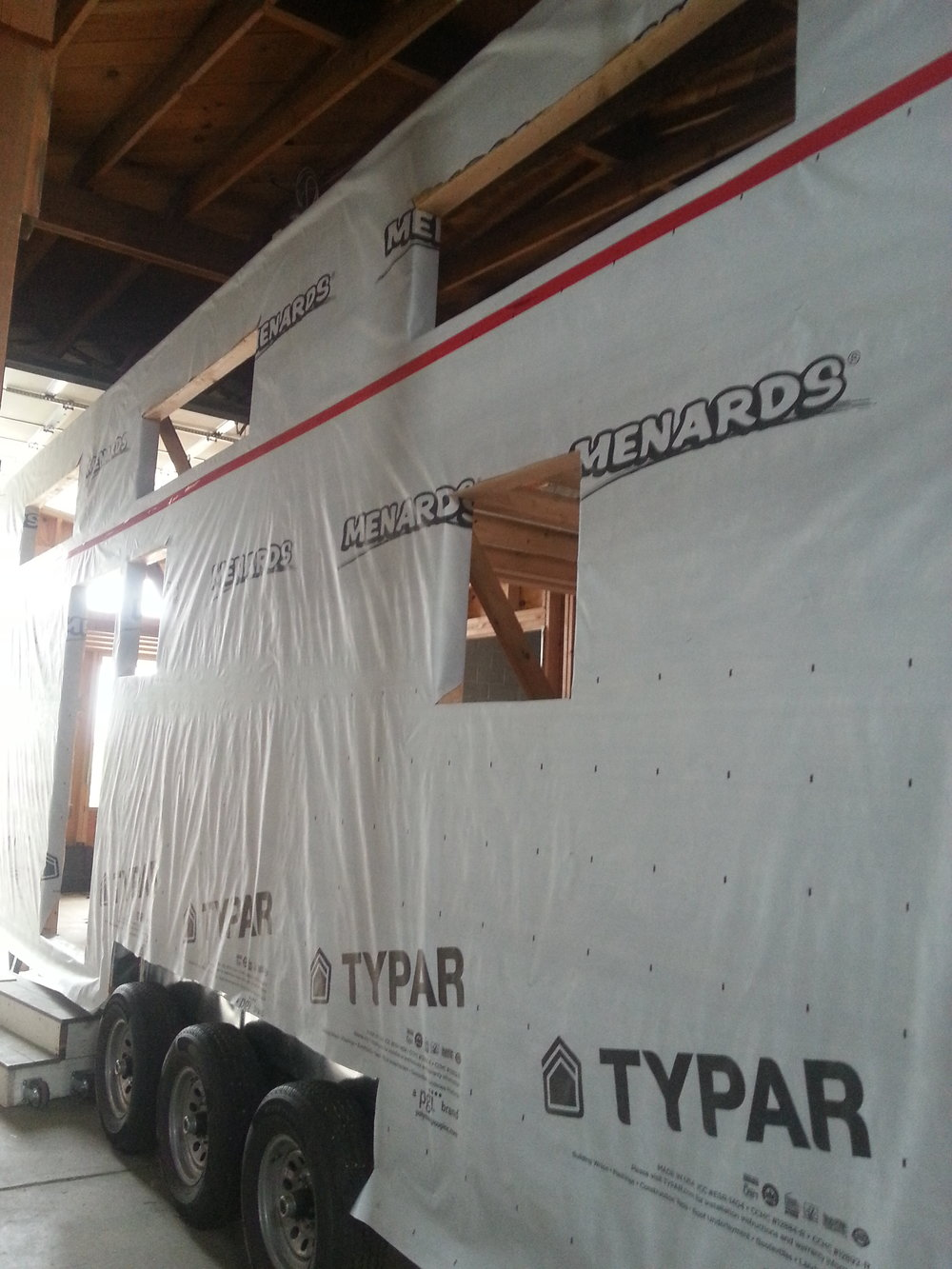 The best thing about house wrap is that it is ass raw ugly, that to me is pure motivation to cover it up as fast as I can.