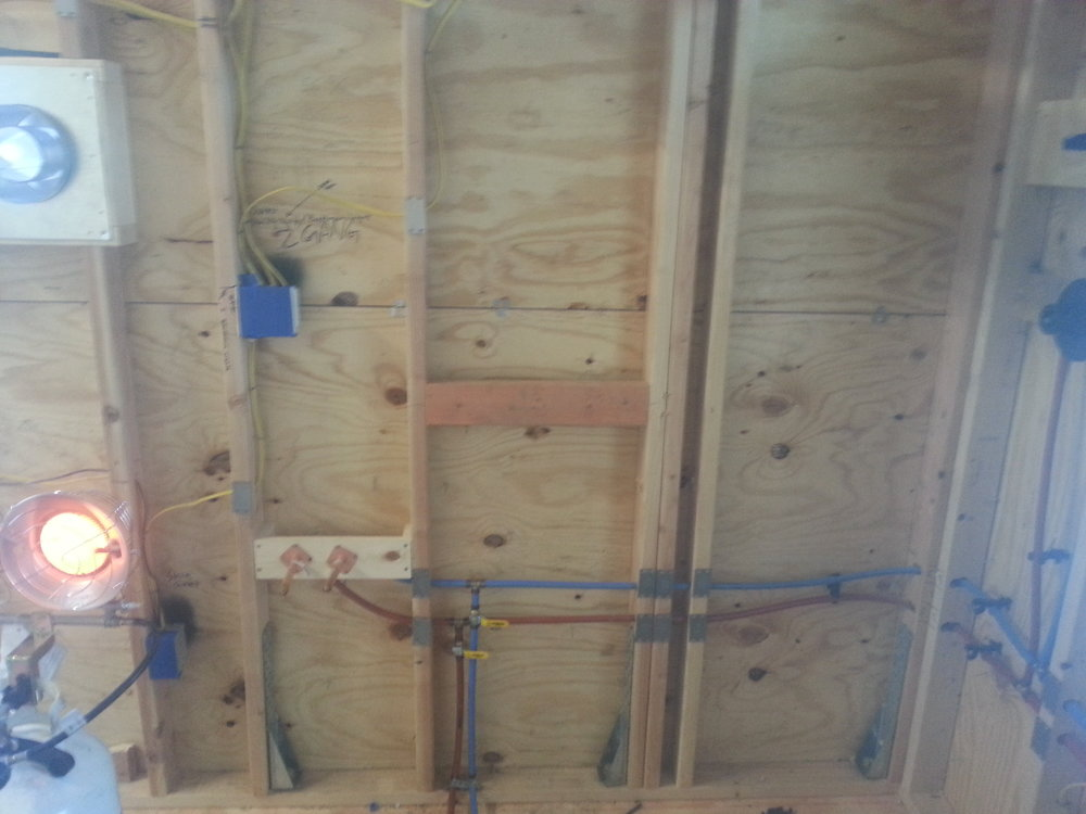 I used PEX lines throughout the entire house because it was easy and is far more resistant to damage in case the pipes do freeze. The only thing I would have done different is put the lines at an even steeper angle toward my drains. The house is easy to drain but there are some low points that trap some water, so I need to use an air compressor to blow all the water out if I winterize it.