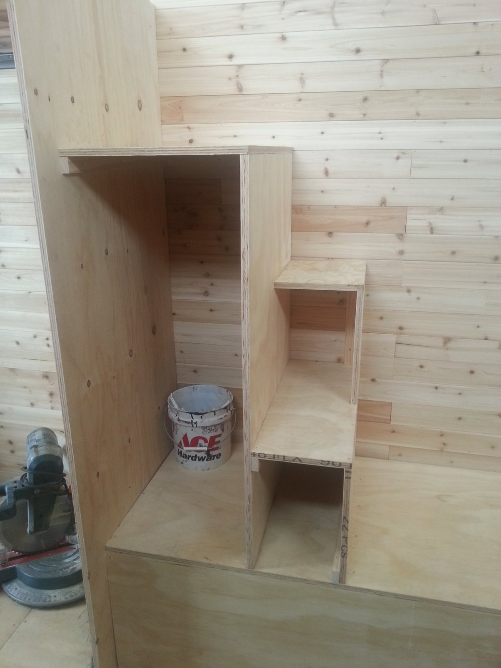 This set of stairs is simple yet very effective, they aren't long and don't take up much space. Perfect little space for books and a decent sized closet for shirts and jackets. Gets me up and down the loft pretty well.