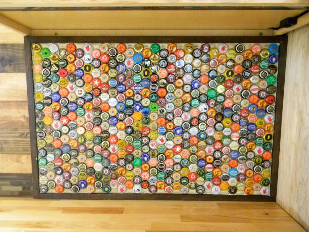 No garbage beers on this bad boy, took quite a while to collect this many bottle caps from craft beers.  Added it all up and figured that at about ten bucks a six pack, this would add up to 750 bucks worth of beer... I need to find a new hobby.  It was a fun little project and its fun to look at.  Made a frame for the caps and slowly started gluing the things in, if I were to do it again I would have used a different glue (not gorilla glue) and some black grout.  Still, just another little thing that will make your project uniquily yours.