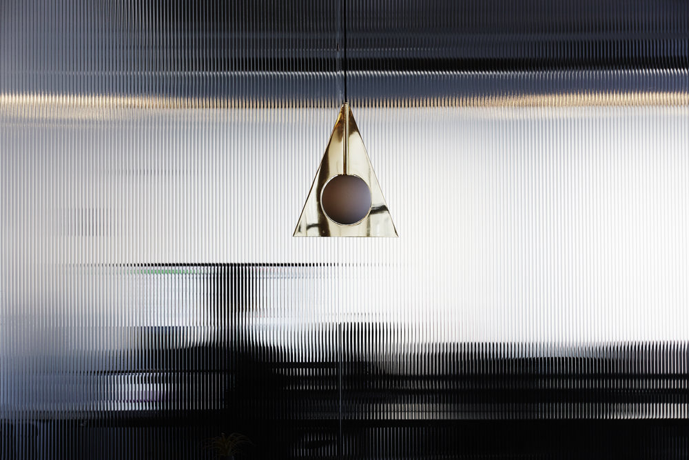 Light fixture in a shared office space