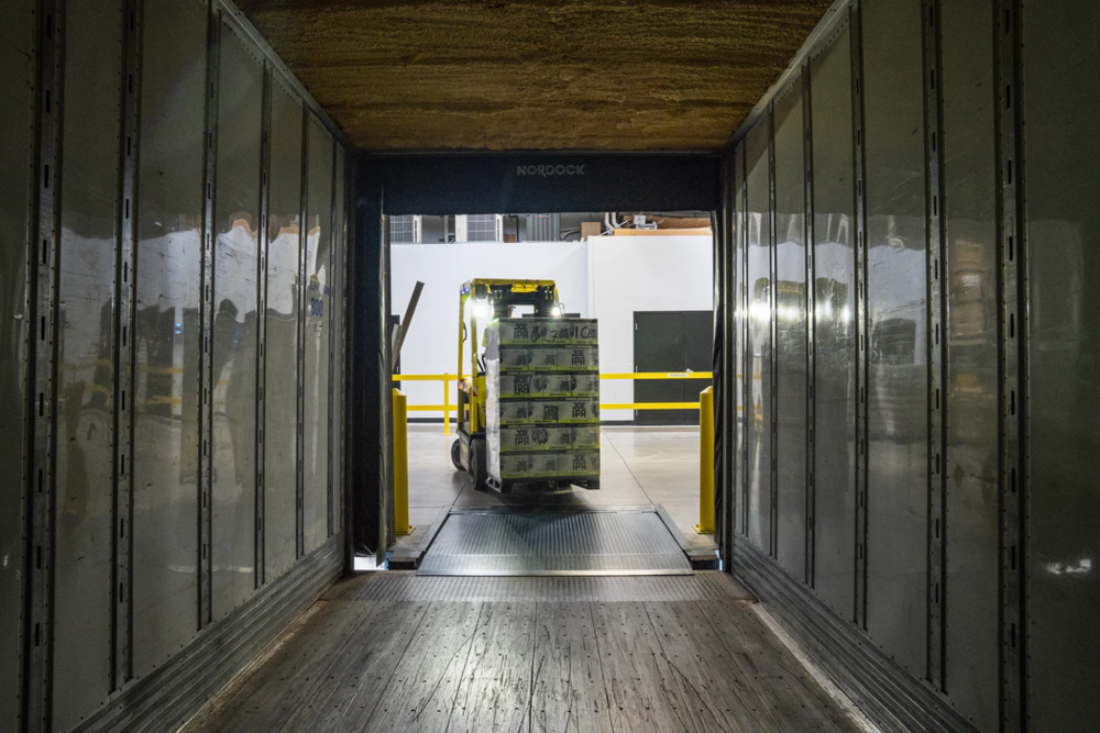 forklift moving items into a moving truck during an office move