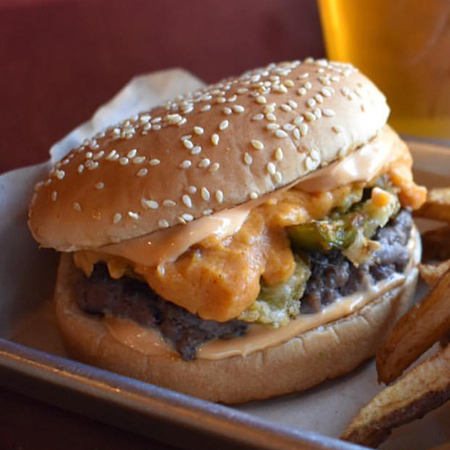 Dirty Dan   1/3 lb. Patty, Deep Fried Jalapeños, Housemade Spicy Cheddar Queso & Texas Lemon Sauce  $8.50