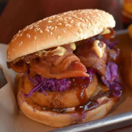 Bullseye   1/3 lb. Patty, Tillamook Sharp Cheddar, Deep Fried Onion Rings, Bacon, Purple Cabbage Slaw, Bull's-Eye BBQ & Wally Sauce  $8.95