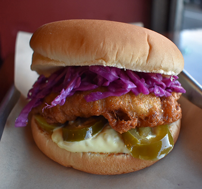 Billy the Cod   Deep Fried Cod Fillet, Purple Cabbage Slaw & Pickled Jalapeños and Tartar Sauce.  $8.5