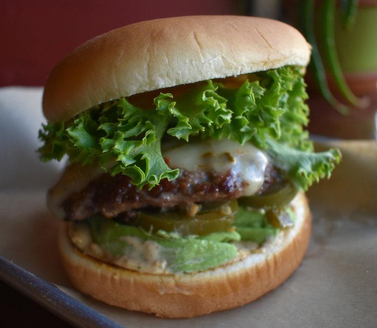 Cannonball  (spicy)  1/3 lb. Patty, Tillamook Pepper Jack, Pickled Jalapeños, Avocado Slices, Lettuce & Helldorado Sauce  $9