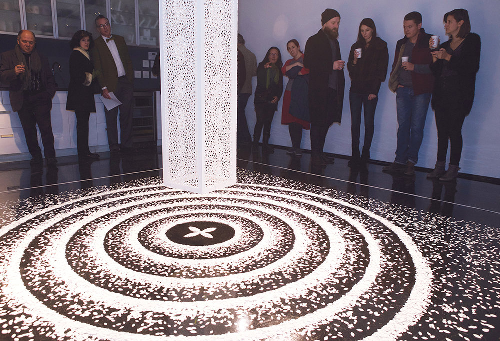 Jaq Belcher, Lunar Codex, Suspended hand-cut paper piece, 12,673 cuts, and a floor piece containing 70,000 paper seeds