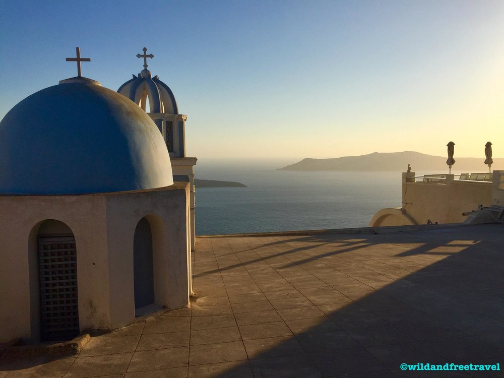 Blue roof church sunset- Santorini, Greece