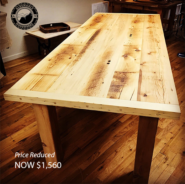 8 Ft Farmhouse table constructed from 100+ year old reclaimed pine beams and planks.  Sale price: $1,560.