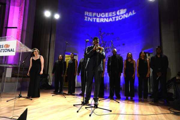 Keyon, Andrea and choir performing at RI gala.jpg
