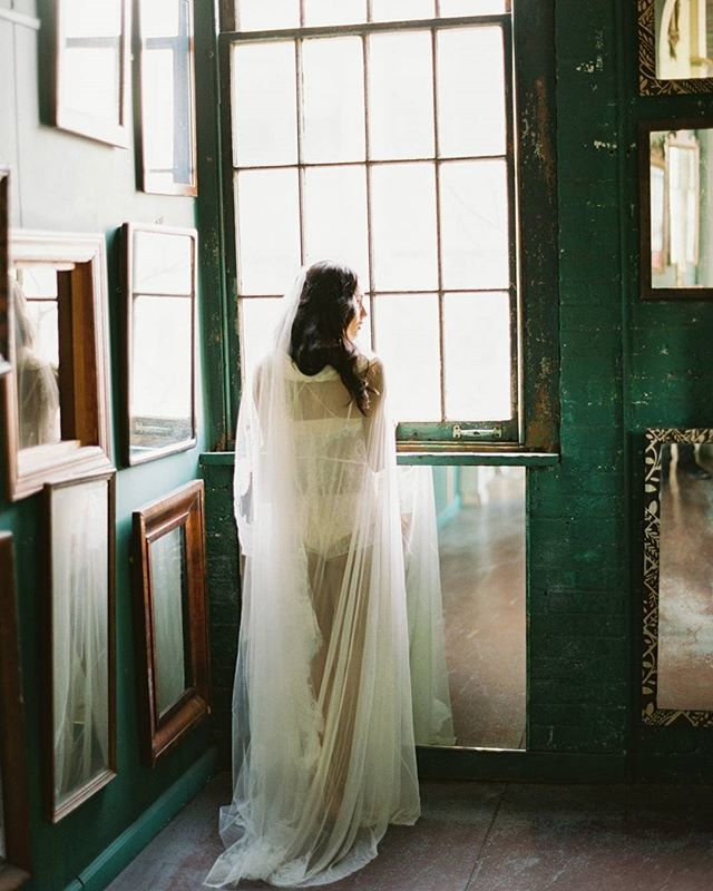 """A hallway of mirrors but she preferred the window"". I'm missing the splendor of New York City right now and thinking back on the beauty of this workshop I was privileged to style for. 2018 is looking bright with more workshops and weddings partnering with photographers and florists I admire traveling to places I've been wanting to experience. My heart is so ready for whats to come.  Photo /@juliannavarettephoto. Processing /@photovisionprints. Workshop /@gatherandgrowevent. Styling /@chicandprettyevents. Attire /@girlandaseriousdream. Make Up /@nataliabbeauty. Hair /@reflection_hairdesign. Print /@deargraymagazine."