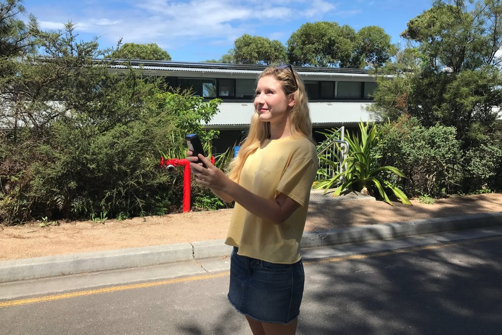 Jessica Farrell tests the solar radiation outside the Sydney Institute of Marine Science.