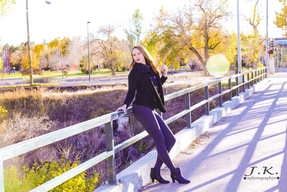 Nola__Posing_On_Bridge_Gold_Hue.jpg